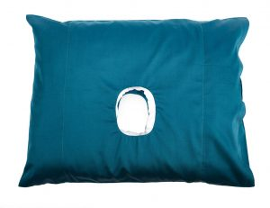 The original pillow with a hole in a blue colour