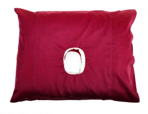 This is a pillow with a hole in a cherry colour