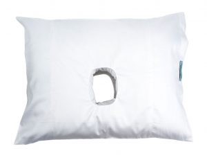 A white cotton sateen pillow with an ear hole.